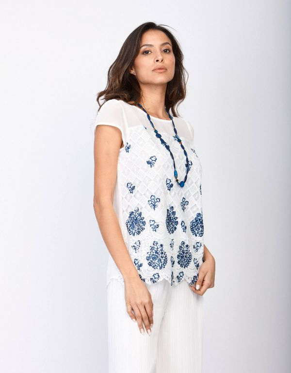 Top in pizzo stampato